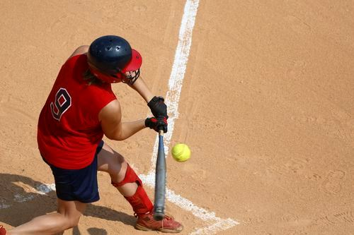 Young Girl Hitting a Softball