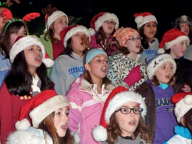 Group of singing Tree Lighting Carollers